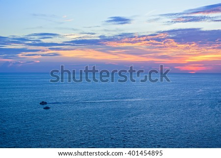 High angle view beautiful landscape of sunset over the Andaman sea from Laem Phromthep Cape scenic point is a famous attractions of Phuket Province in Thailand - stock photo