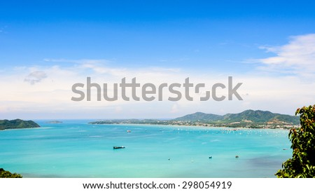 High angle view blue sky over the Andaman Sea and seaside tourist town from Khao-Khad mountain viewpoint famous attractions in Phuket island, Thailand, 16:9 Wide Screen - stock photo