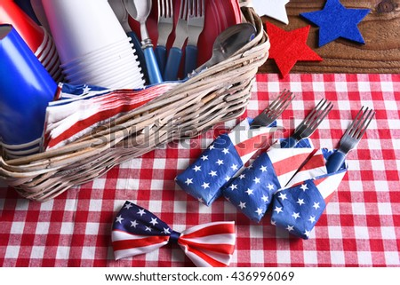 High angle view of a patriotic picnic table set for a 4th of July celebration. Horizontal format. - stock photo