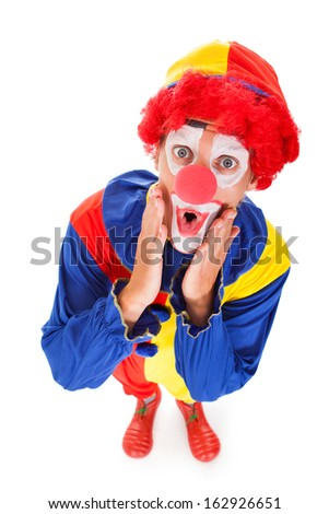 High Angle View Of A Shocked Joker White Background - stock photo