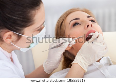 High Angle View Of A Woman Having Her Dental Checkup - stock photo