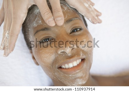 High angle view of a woman receiving facial treatment