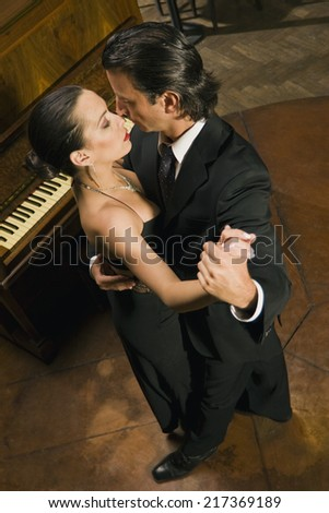 High angle view of a young couple dancing - stock photo