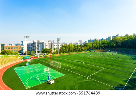 High angle view of artificial turf on the athletic soccer field at the track stadium on the campus of Korea University in Seoul, South Korea. Horizontal