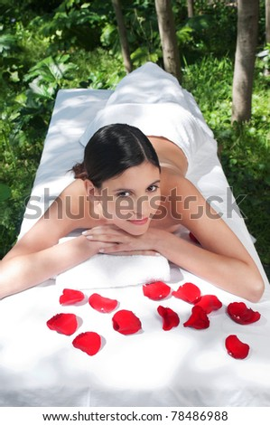 High angle view of beautiful young woman at a spa - stock photo