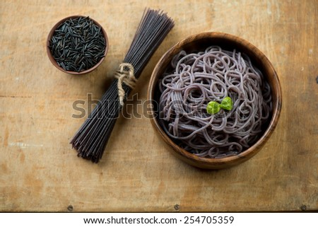 High angle view of black rice noodles, selective focus - stock photo
