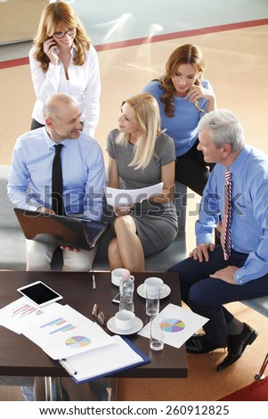 High angle view of business people discussing in a meeting. Teamwork at office.  - stock photo