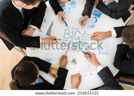 High Angle View Of Businesspeople Planning Bigdata - stock photo