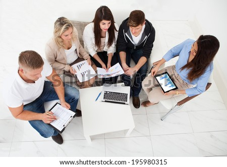 High angle view of businesspeople working in office - stock photo
