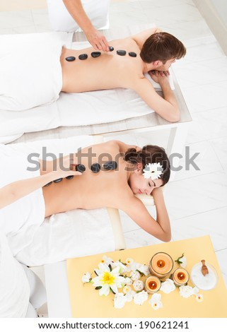 High angle view of couple receiving Lastone therapy at beauty spa - stock photo