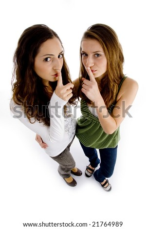 high angle view of girls shushing on an isolated background - stock photo