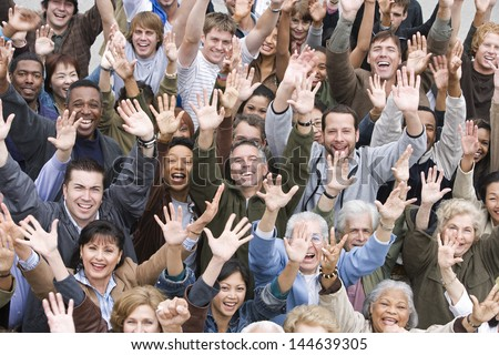 High angle view of group of happy multiethnic people raising hands together - stock photo