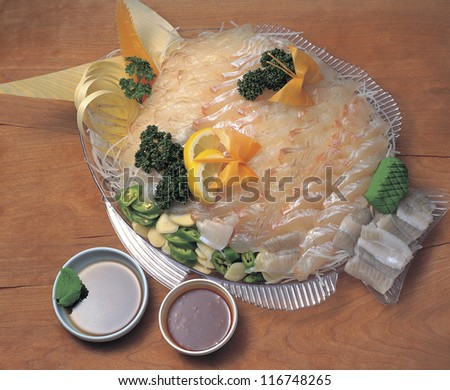 High angle view of Halibut sashimi in a fish shaped dish - stock photo