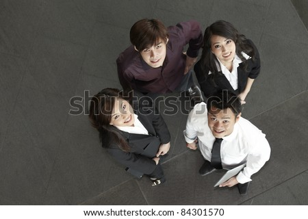 High angle view of happy Asian business people