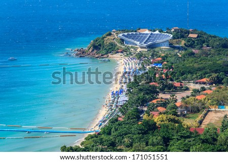 High Angle View Of Island And Small Village Using Energy From Solar Power Station And Wind Power Alternative Energy Turbine - stock photo