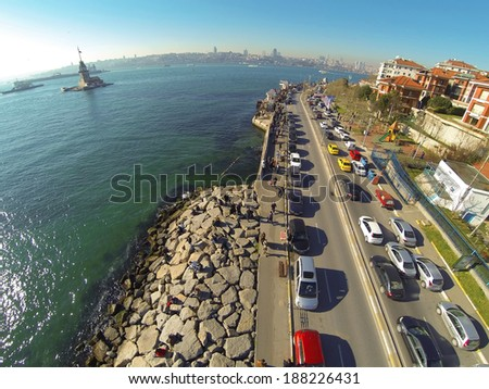 High angle view of Istanbul towards Uskudar coastline. Aerial camera showing Maidens Tower and Bosporus Sea as well as Uskudar - Harem Street at a sunny spring day - stock photo