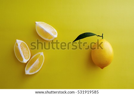 High Angle View Of Lemon Arranged Over Yellow Background