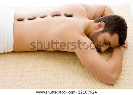 high angle view of man lying down on mat at spa - stock photo