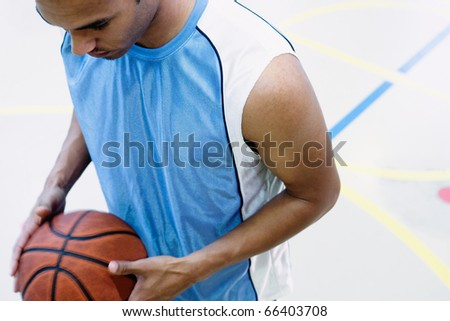 High angle view of man playing basketball - stock photo