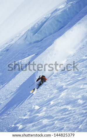 High angle view of man skiing on steep slope - stock photo