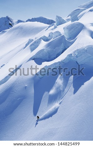 High angle view of man snowboarding on steep slope