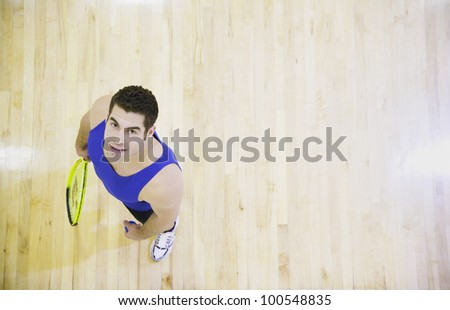 High angle view of man with Squash racket - stock photo