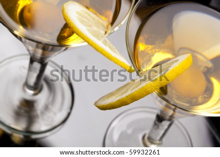 High angle view of martini  isolated on black focus on rim of glass and lemon slice. Shallow depth of field. High view - stock photo