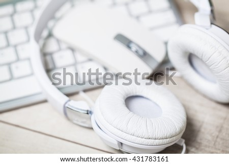 High Angle View of Modern Audio Headphones with Cord and Mouse on Grey Desk Background with Copy Space. Selective focus.