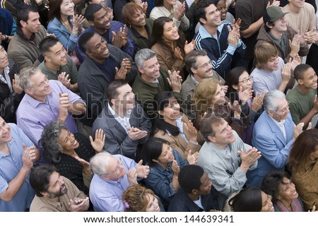 High angle view of multiethnic people clapping together - stock photo