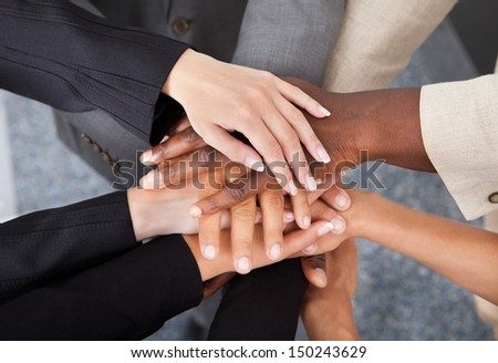 High Angle View Of Multiracial Businesspeople Stacking Hands Over Each Other - stock photo