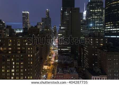 High angle view of New York city buildings at night - stock photo