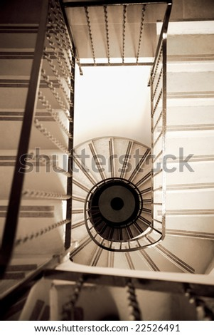 high angle view of old spiral staircase - stock photo