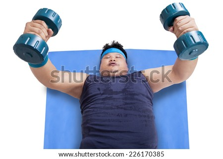 High angle view of overweight man lifting two barbells, isolated on white background - stock photo
