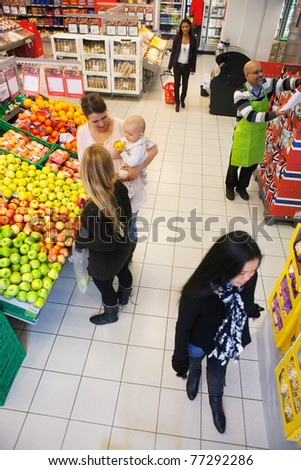 High angle view of people buying in supermarket - stock photo
