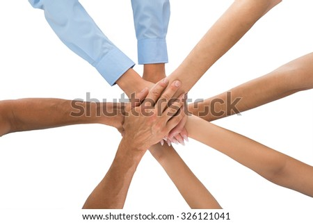 High Angle View Of People Stacking Hands Together - stock photo