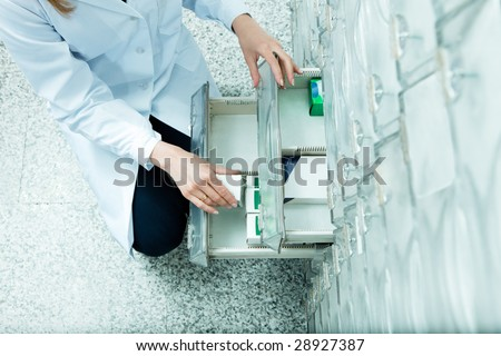 high angle view of pharmacist taking medicine from drawer. Copy space - stock photo