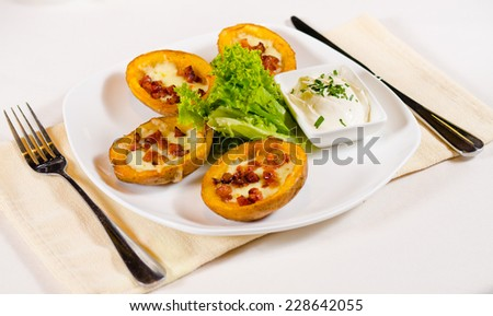 High Angle View of Potato Skins Appetizer with Dipping Sauce Served in Restaurant - stock photo