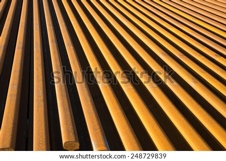 High angle view of rails piled on a railroad construction site - stock photo