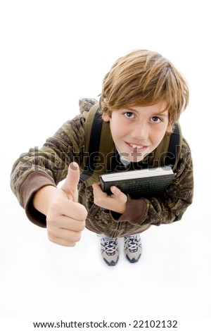 high angle view of smiling school boy with thumbs up with white background - stock photo