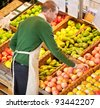 High angle view of store worker working in a grocery store - stock photo