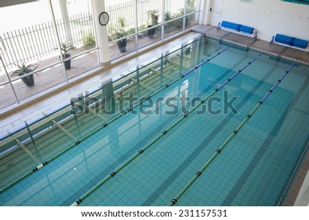 High angle view of swimming pool in fitness club - stock photo