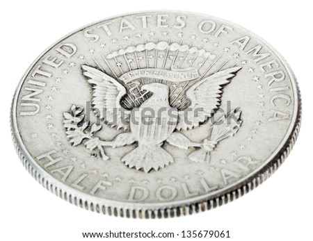High angle view of the obverse (heads) side of a silver half Dollar minted in 1964 (Kennedy half dollar). Depicted is the US presidential seal. Isolated on white background. - stock photo