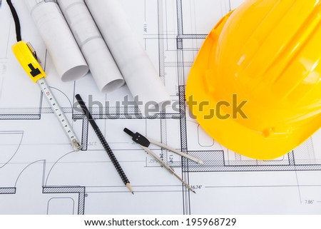 High angle view of tools with hardhat on blueprint - stock photo