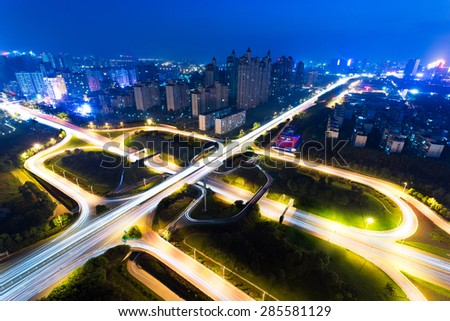 High angle view of traffic light trails on overpass - stock photo