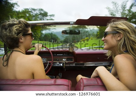 High angle view of two young women in a car