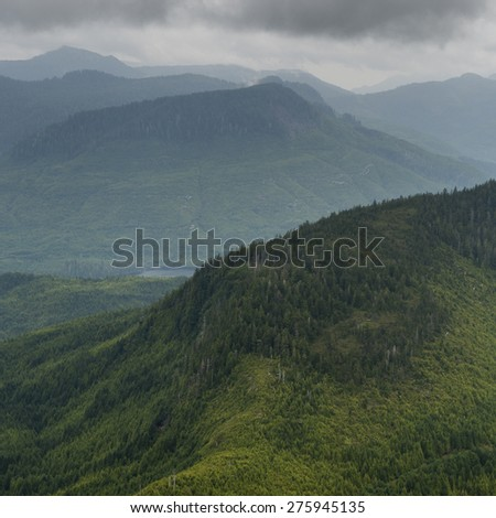High angle view of valley with mountains, Skeena-Queen Charlotte Regional District, Haida Gwaii, Graham Island, British Columbia, Canada - stock photo