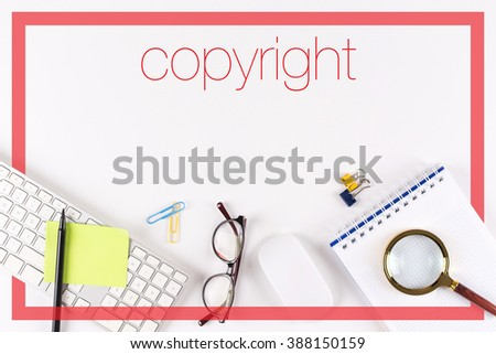 High angle view of various office supplies on desk with a word Copyright