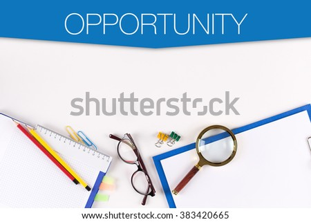 High Angle View of Various Office Supplies on Desk with a word OPPORTUNITY - stock photo