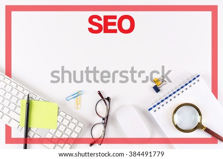 High Angle View of Various Office Supplies on Desk with a word SEO - stock photo