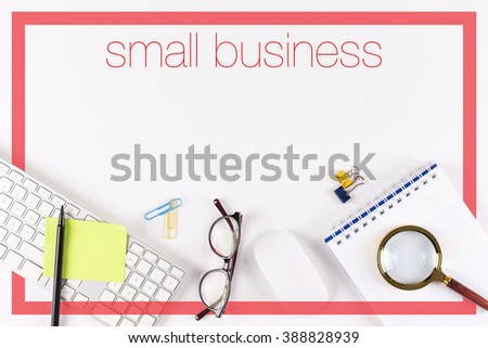 High angle view of various office supplies on desk with a word Small Business
